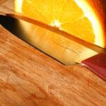Trillium Paring Knife reflecting Orange