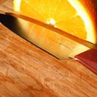 Trillium Paring Knife reflecting Orange
